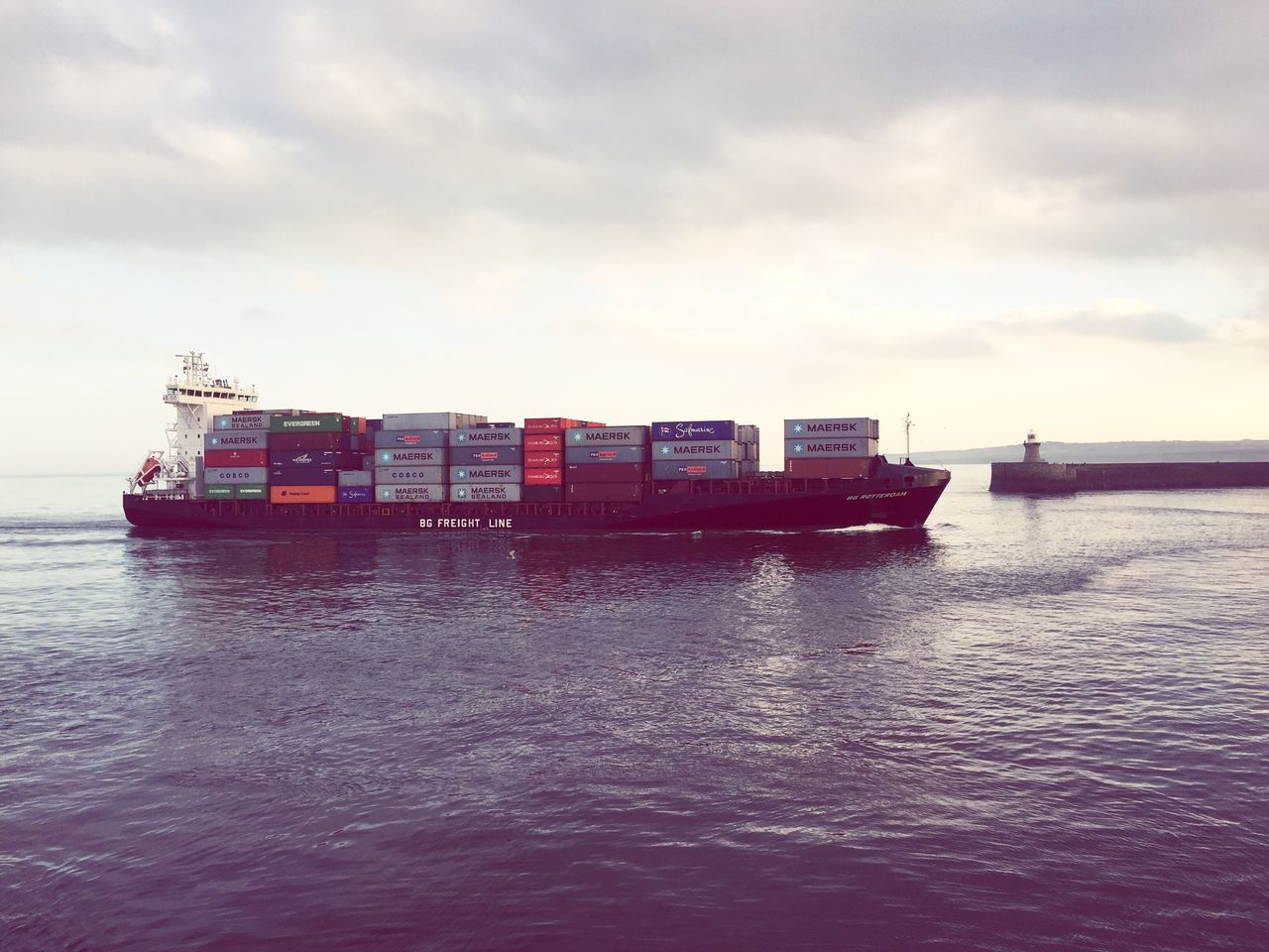 transportation, freight transportation, nautical vessel, water, cargo container, mode of transport, container ship, sea, waterfront, shipping, container, day, sky, cloud - sky, outdoors, industry, scenics, nature, commercial dock, sailing, no people, beauty in nature, harbor, shipyard