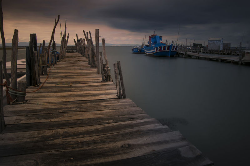 Architecture Built Structure Cloud - Sky Direction Mode Of Transportation Moored Nature Nautical Vessel No People Outdoors Pier Scenics - Nature Sea Sky The Way Forward Tranquility Transportation Water Wood - Material Wooden Post