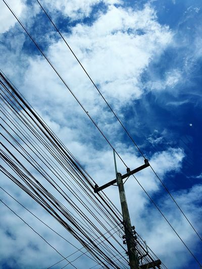 Cable Connection Low Angle View Sky Cloud - Sky Power Supply Power Line  Electricity  Fuel And Power Generation Technology Electricity Pylon No People Day Outdoors Telephone Line Nature