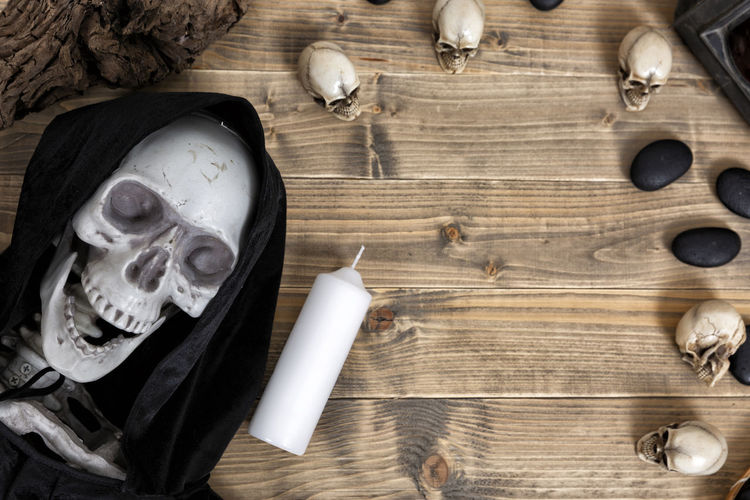 Halloween Halloween EyeEm Bone  Bowl Close-up Craft Crockery Day Directly Above Food And Drink High Angle View Household Equipment Human Skeleton Indoors  Nature No People Old Skulls And Bones Skulls💀 Spooky Still Life Table Wood - Material