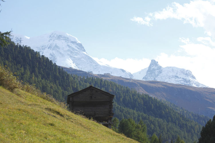 Breithorn and Klein Matterhorn with wooden hut, Zermatt, Switzerland Al Beauty In Nature Berghütte Brethorn Day Hut Hütte Idyllic Klein Matterhorn Landscape Meadow Mountain Mountain Range Nature No People Outdoors Rural Scene Scenics Schweiz Sky Tranquil Scene Tranquility Tree Wooden Zermatt