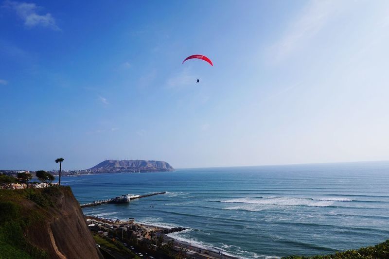 Sea Water Horizon Over Water Beach Outdoors Nature Scenics Adventure Parachute Beauty In Nature Day Sport Mid-air Sky Extreme Sports Vacations Paragliding Lifestyles Flying Clear Sky EyeEmNewHere
