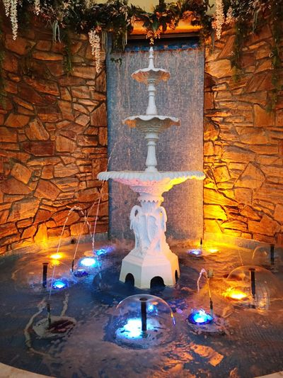 Fountain At LA FONTAINE BLEUE Fountain Human Representation Art And Craft Flame Burning Sculpture Statue Religion