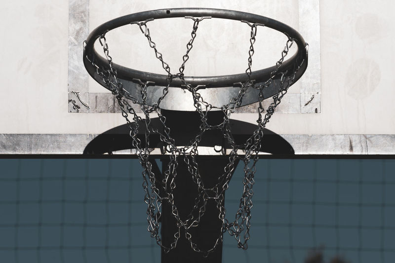 Basketball hoop close up Basketball Hoop Growth Match - Sport Competition Playing Field Athletics Team Sport Chain Metallic Outdoors Geometric Shape No People Net - Sports Equipment Basketball - Sport Score Target Practice Goal Competitive Sport Close-up Low Angle View Metal Sport Shape