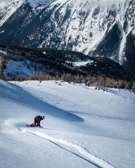 Adventure Backcountry Snowboarding Beauty In Nature Cold Temperature Day Deep Snow Landscape Leisure Activity Lifestyles Mountain Nature Off Piste One Person Outdoors Powder Snow Real People Scenics Ski Holiday Snow Snowboarding Snowcapped Mountain Splitboarding Sport Vacations Winter