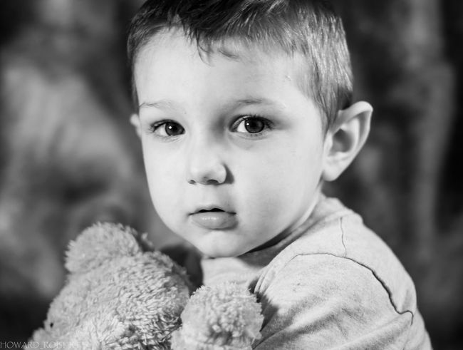 My son and his teddy bear black and white Babyhood Boys Casual Clothing Childhood Close-up Cute Elementary Age Focus On Foreground Front View Girls Headshot Innocence Leisure Activity Lifestyles Looking At Camera Person Portrait