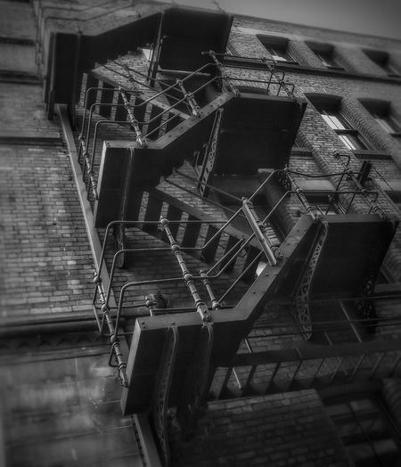 Fire escape on a building in Manchester Built Structure Architecture Spiral Staircase Close-up Monochrome Photography Architectural Detail Fujifilm Malephotographerofthemonth Creative Light And Shadow The World Through My Eyes Bnw_captures Bnw Photography Architecture Portrait Photography Black & White Photography Black And White Photography Man Made Structure Streets Of Manchester The Architect - 2017 EyeEm Awards