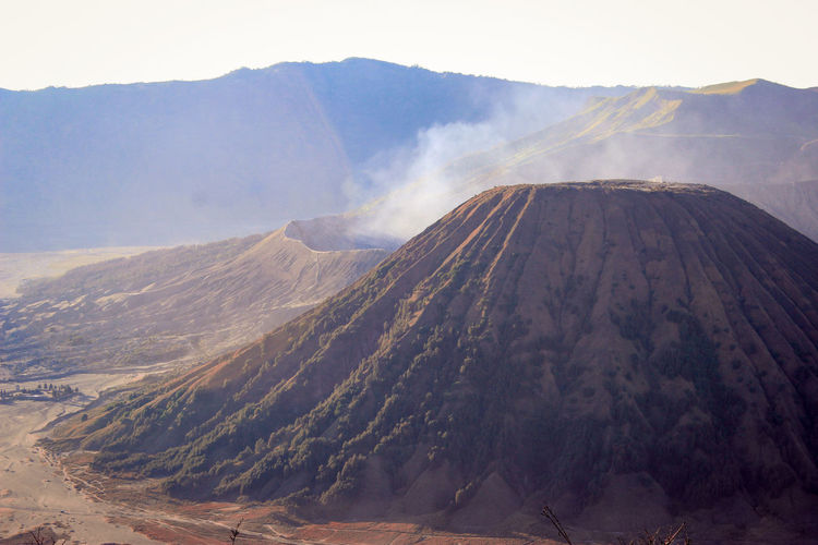 Mountain Landscape Geology Land Environment Volcano Nature No People Beauty In Nature Volcanic Crater Outdoors Fog Non-urban Scene Travel Destinations Smoke - Physical Structure Scenics - Nature Day Cloud - Sky Sky Mountain Peak