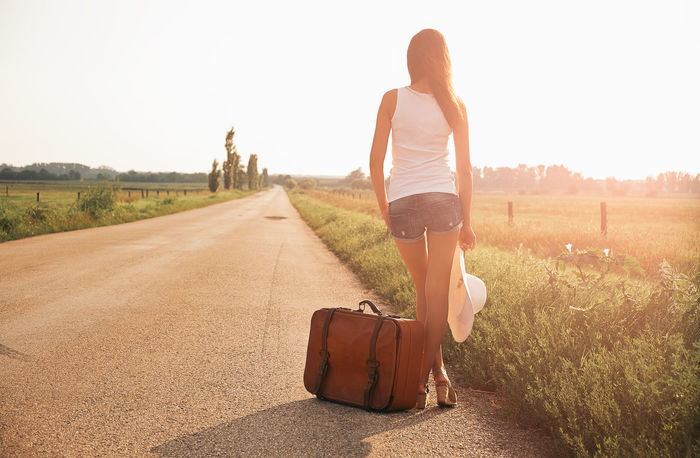 Beautiful traveller woman Adult Adventure Attractive Bag Beautiful Free Freedom Girl Hitchhiker Hitchhiking Journey Outdoors Road Suitcase Summer Tourist Travel Traveller Trip Vintage Woman Young