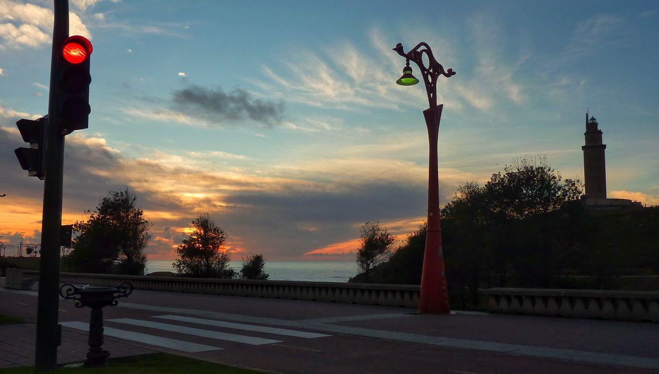 Antique Street Light On Roadside Against Sunset Sky