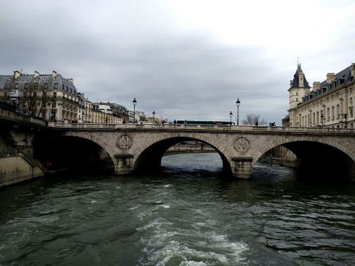 Bridge - Man Made Structure Travel Destinations River Architecture Connection Rain Arch Travel City Outdoors Built Structure Cloud - Sky History Sky No People Cityscape Water Nature Day Paris