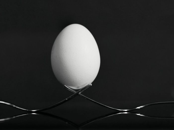 Close-up of egg against black background