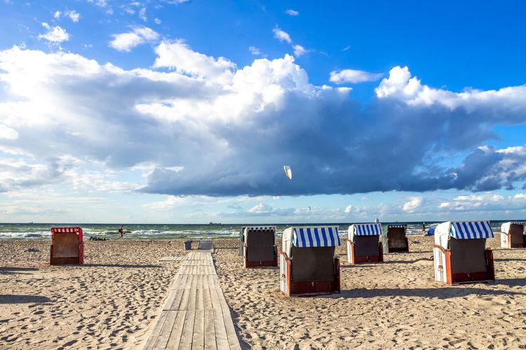 Hooded Chairs Sandy Beach Against Sky