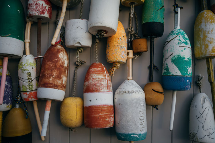 Close-up of various objects hanging on wall