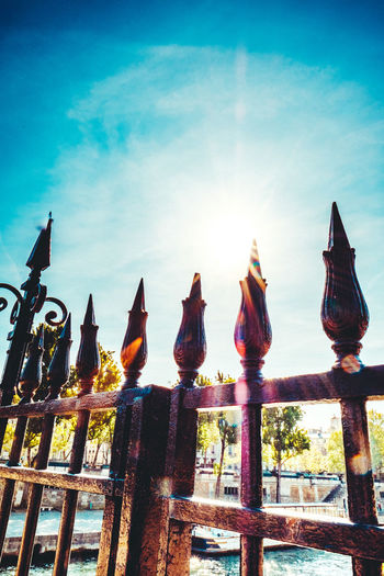 Architecture Art And Craft Blue Sky Close-up Cloud - Sky Day Fence Fences Fences & Beyond Human Representation Low Angle View Nature No People Outdoors Religion Sculpture Sky Spirituality Statue Sunrays