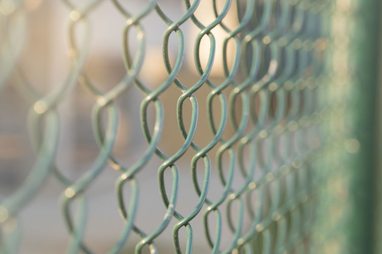 Wire cage wall with sun light. Wall Abstractbird Backgrounds Cage Chainlink Fence Close-up Day Full Frame Metal No People Outdoors Pattern Protection Safety Security Wire