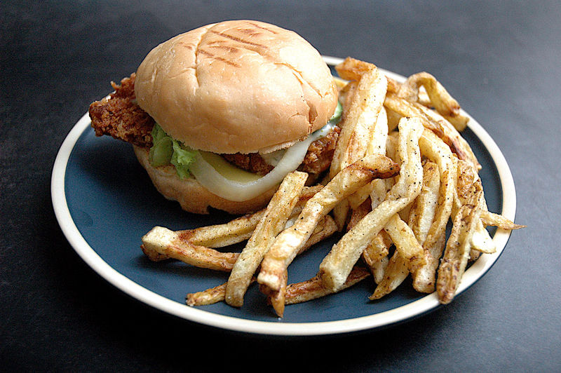 Close-up of fresh burger in plate on table