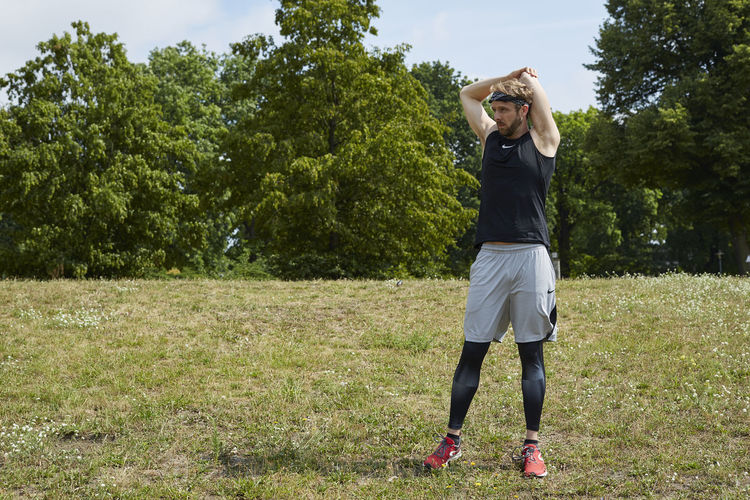 Full length of woman standing on field
