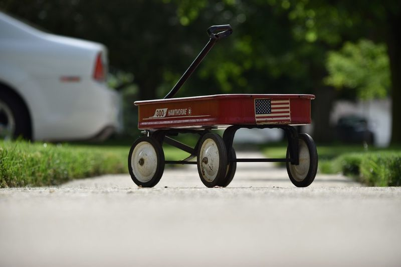 All American cart Mode Of Transportation Transportation Day Plant Land Vehicle No People Outdoors Toy Selective Focus Street Road