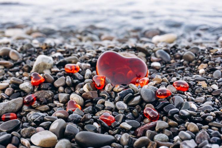 Close-up of heart shape pebbles on beach