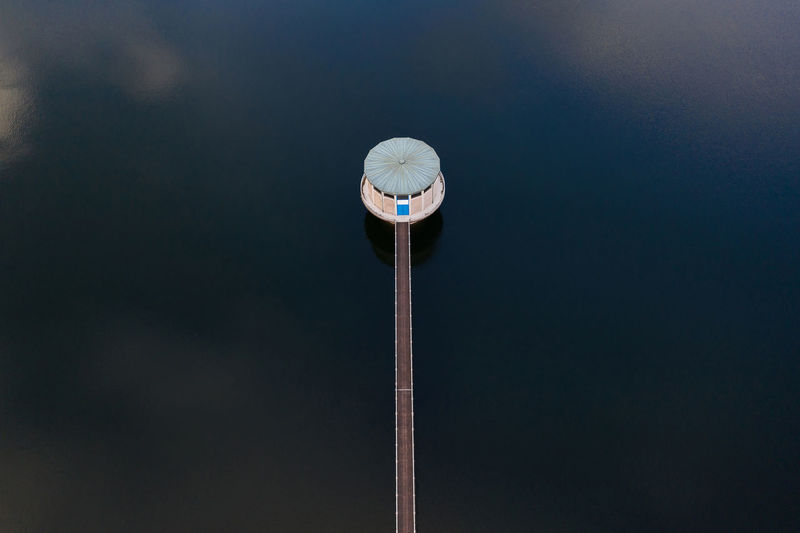 Low angle view of pole against sky at night