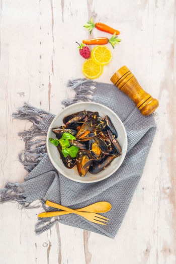 High Angle View Of Mussels Served In Bowl On Table
