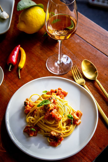 """Fresh pasta with """"Berlin lobster"""" (invasive red crayfish) Food And Drink Food Table Plate Pasta Freshness Ready-to-eat Italian Food Eating Utensil Healthy Eating Kitchen Utensil Indoors  Glass No People Meal Fruit Spaghetti Herb Dinner Crayfish Crab Crab Meat Seafood Dinner Wine Crustacean"""
