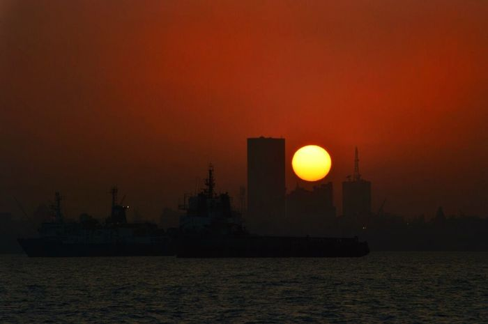 The city's sunset. Mumbai Colaba Mumbaicity Scenics Sunset Sea Travel Destinations Silhouette No People Built Structure Sun Outdoors Nautical Vessel Architecture City Colour Your Horizn