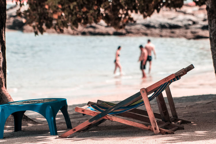 Deck chairs and table at beach