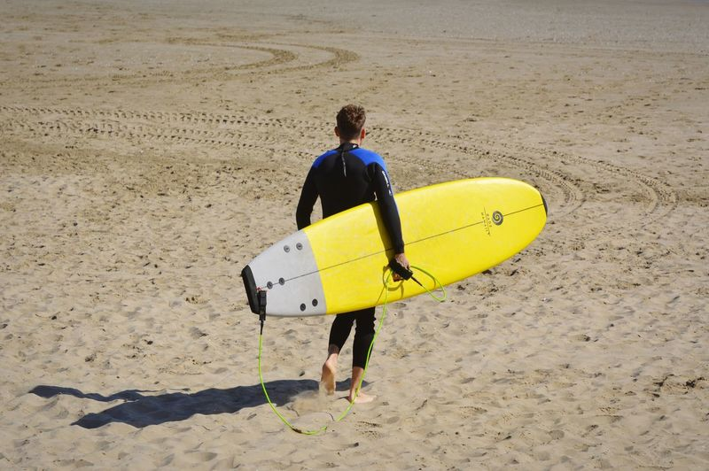Travel Destinations Week On Eyeem Full Length Beach Adventure Sand Yellow Sportsman Rear View Men Extreme Sports Sunlight Surfboard Surfing Water Sport Surf Wave Surfer Kiteboarding Windsurfing Aquatic Sport My Best Photo