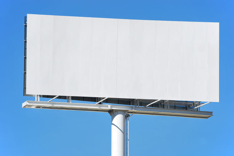 Advertisement Architecture Billboard Blank Blue Built Structure Clear Sky Communication Copy Space Day Empty Low Angle View Marketing Message Metal Nature No People Outdoors Sign Sky White Color