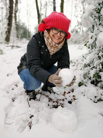 Woman playing with snow Leafs Gloves White Snowball Fight Cold Temperature Germany European  Woman Snow Snowball Playing Outdoors Forset Beatiful Nature Winter Warm Clothing Knit Hat One Person Snowman Holding Happy EyeEmNewHere