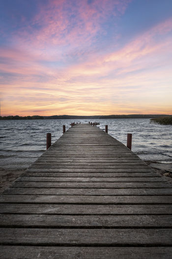 Pier at Sunrise Sky Sea Sunset Direction The Way Forward Water Pier Wood - Material Horizon Horizon Over Water Tranquility Beauty In Nature Scenics - Nature Cloud - Sky Jetty Tranquil Scene Land Diminishing Perspective Beach Outdoors Wood Paneling Wood Pier Dock Sunrise
