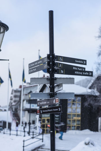Close-up Cold Temperature Communication Day Direction Focus On Foreground Guidance Nature No People Outdoors Railway Signal Road Sign Signal Sky Snow Stoplight Text Transportation Winter