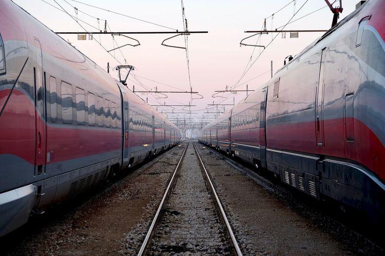 Trains on railroad track against sky
