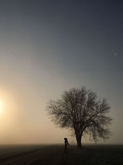 Winter is coming Sky One Person Tree Full Length Nature Bare Tree Environment Silhouette Fog Horizon Over Land Beauty In Nature Tranquility Outdoors A New Beginning Capture Tomorrow