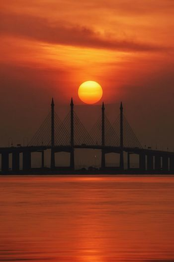 Scenic view of suspension bridge against sky during sunset