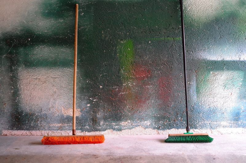 Brooms against wall