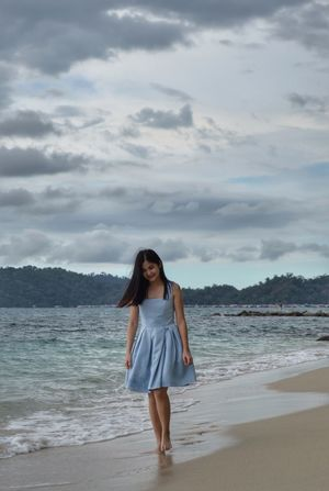 Walking on a rainy day @ the beach One Woman Only Beach Sea One Person One Young Woman Only Sand Standing Sky Portrait Long Hair Kota Kinabalu, Sabah Borneo Kota Kinabalu Malaysia