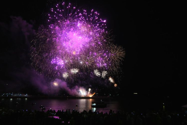 Plymouth Devon Firework Display Astronomy Galaxy Milky Way Arts Culture And Entertainment Water Illuminated Purple Multi Colored Firework Display City Entertainment Firework - Man Made Object Event Smoke - Physical Structure Sparks Emitting Exploding Firework