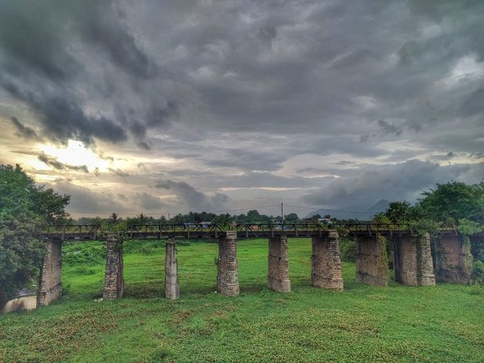 The Old and now closed down Narakampilly bridge on NH47 in Palakkad, Kerala. Ancient Architecture Bridge Clouds Clouds And Sky Day Grass India Kerala Landscape Nature Old Outdoors Palakkad Sky Tree