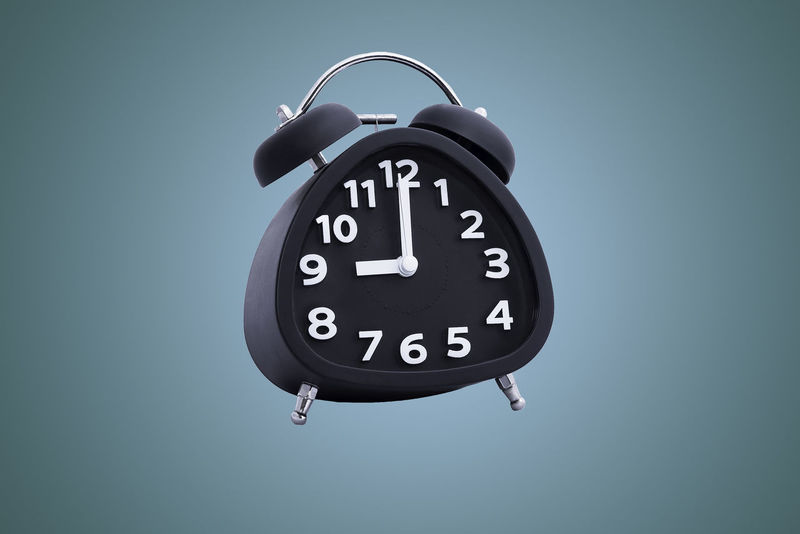 Alarm clock set to 9 o'clock. 9oclock Alarm Clock Background Color Clock Clock Face Close-up Day Hour Hand Minute Hand No People Single Object Time