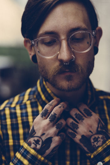 Young men wearing eyeglasses Glasses Eyeglasses  One Person Facial Hair Beard Front View Men Males  Portrait Headshot Adult Close-up Real People Young Adult Lifestyles Hipster - Person Mustache Hairstyle Focus On Foreground Fashion Piercing Millenials 50 Ways Of Seeing: Gratitude