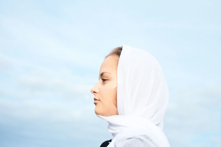 EyeEmNewHere One Person Lifestyles Sky Young Adult Portrait Headshot Women Day Young Women Adult Side View Human Body Part Real People Towel Looking Waist Up Body Part Beautiful Woman Outdoors Hood - Clothing Mood Minimalism Modern Beauty This Is Natural Beauty My Best Photo