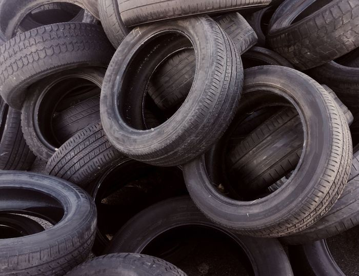 Tire Industry No People Full Frame Auto Repair Shop Metal Industry Tire Industry Recuperation Old Tires Used Tires Accumulation Recycling Materials Recycling Close-up Materials