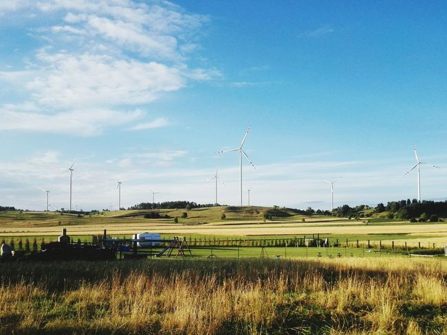Agriculture Rural Scene Sky Fuel And Power Generation Electricity  Business Finance And Industry Nature Alternative Energy Field Wind Turbine No People Landscape Grass Outdoors Renewable Energy Electricity Pylon Day
