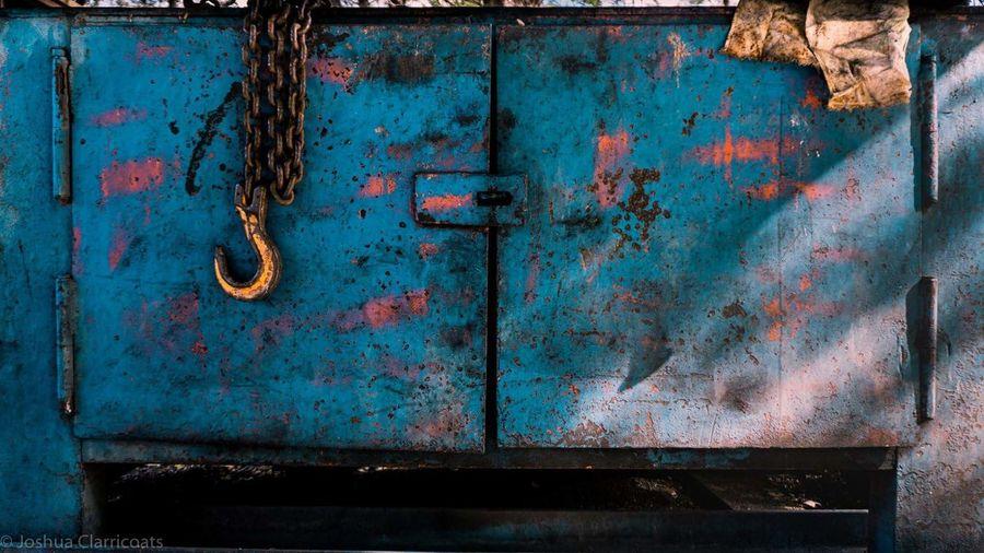 Close-Up Of Rusty Metal Door With Chain