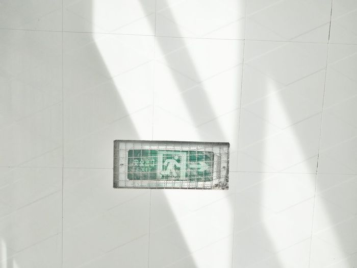 Exit sign on tiled wall