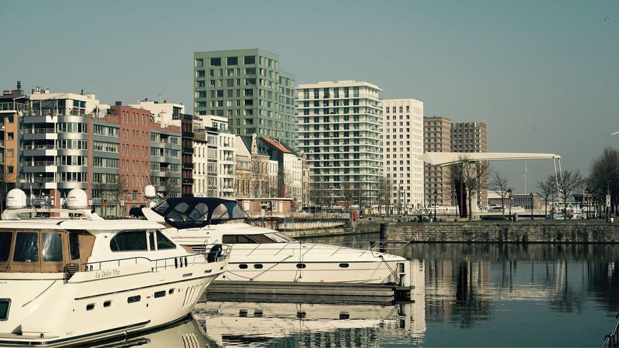 Antwerpen March 2019 Reflection In The Water Yachts Ship Dock Quay Port Travel Built Structure Building Exterior Architecture City Building Water Mode Of Transportation Nautical Vessel Transportation Office Building Exterior Reflection Cityscape Tall - High No People Residential District City Life Waterfront Nature Day Sky