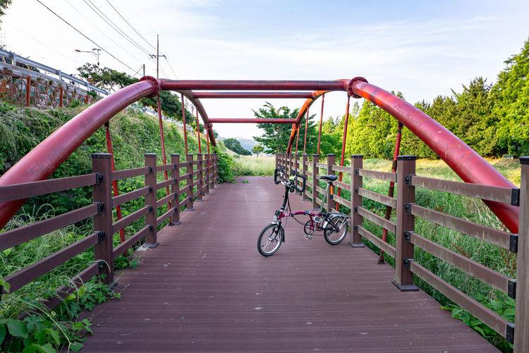 Bicycle footbridge against sky